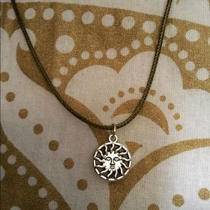 Sun medal, designed by The Hustle. Cord necklace.